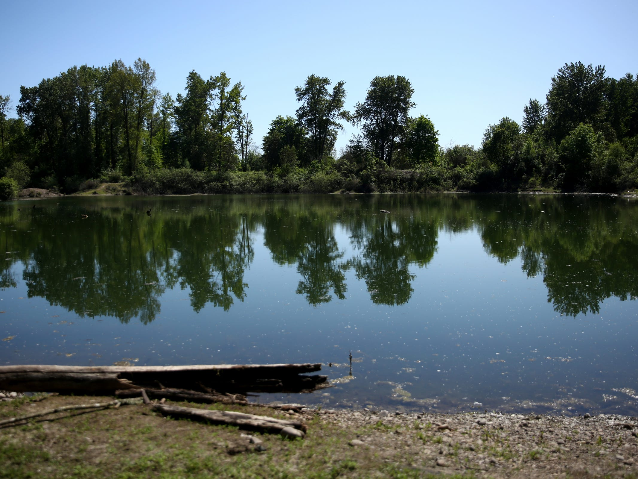 A lake in a homeless camp near Wallace Marine Park in West Salem on May 6, 2019. Signs were posted throughout the camp recently stating personal property must be removed or it will be taken by the landowner and its designated agent starting May 7.