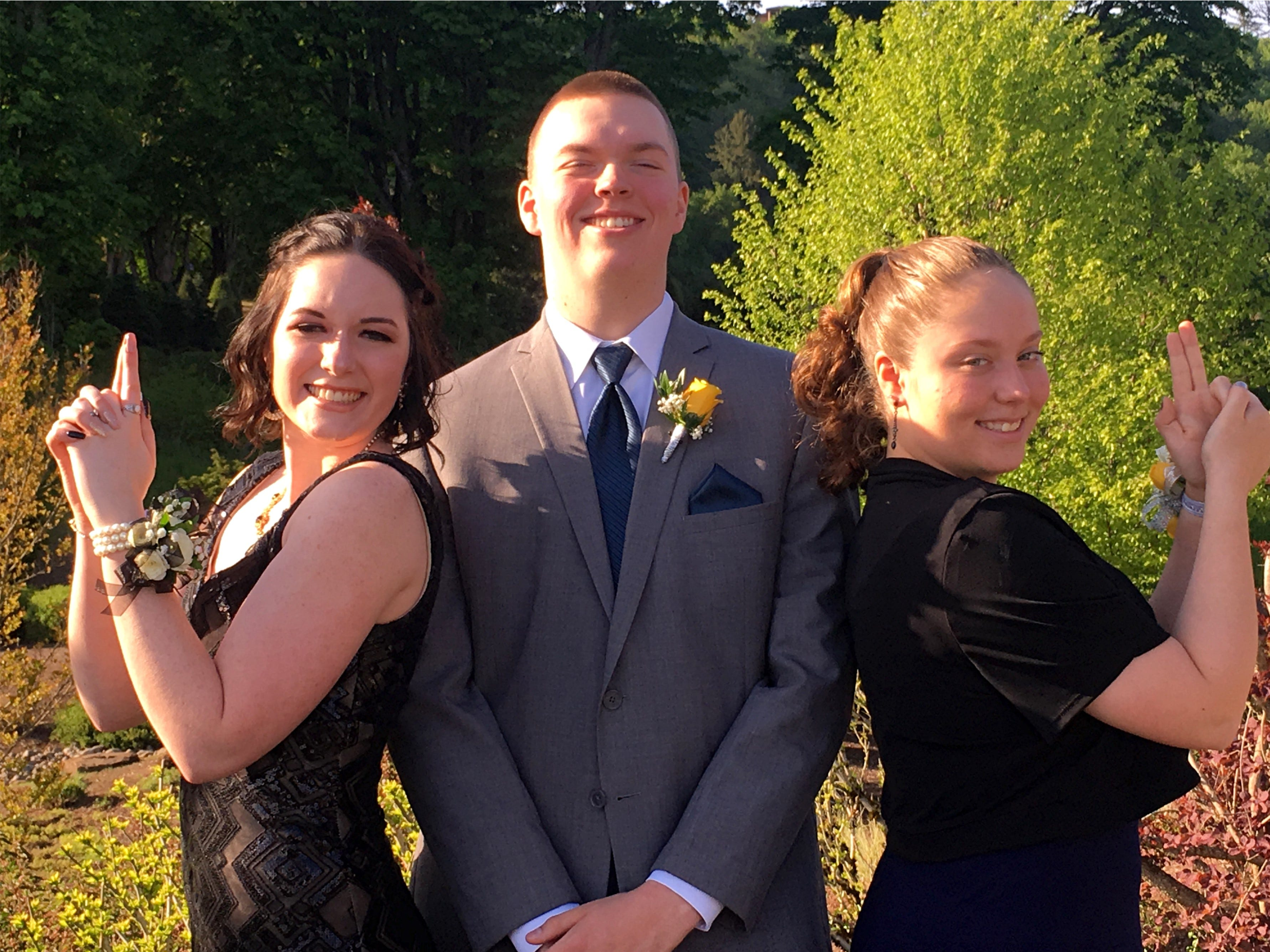 Mikayla Wood (Scio, junior), Garrett Kincaid (Lyons, senior) and his sister Sidney Kincaid (Lyons, junior) pose for photos at the Oregon Connections Academy's fourth annual prom at Eola Viticulture Center, May 4th, 2019. Garrett is the Student Body President and Mikayla is the Vice President.