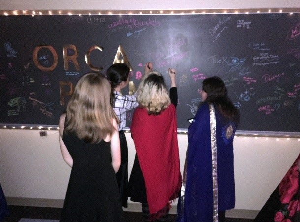 Students write messages during the Oregon Connections Academy prom held at the Chemeketa Community College Eola Viticulture Center in Salem, May 4th, 2019.