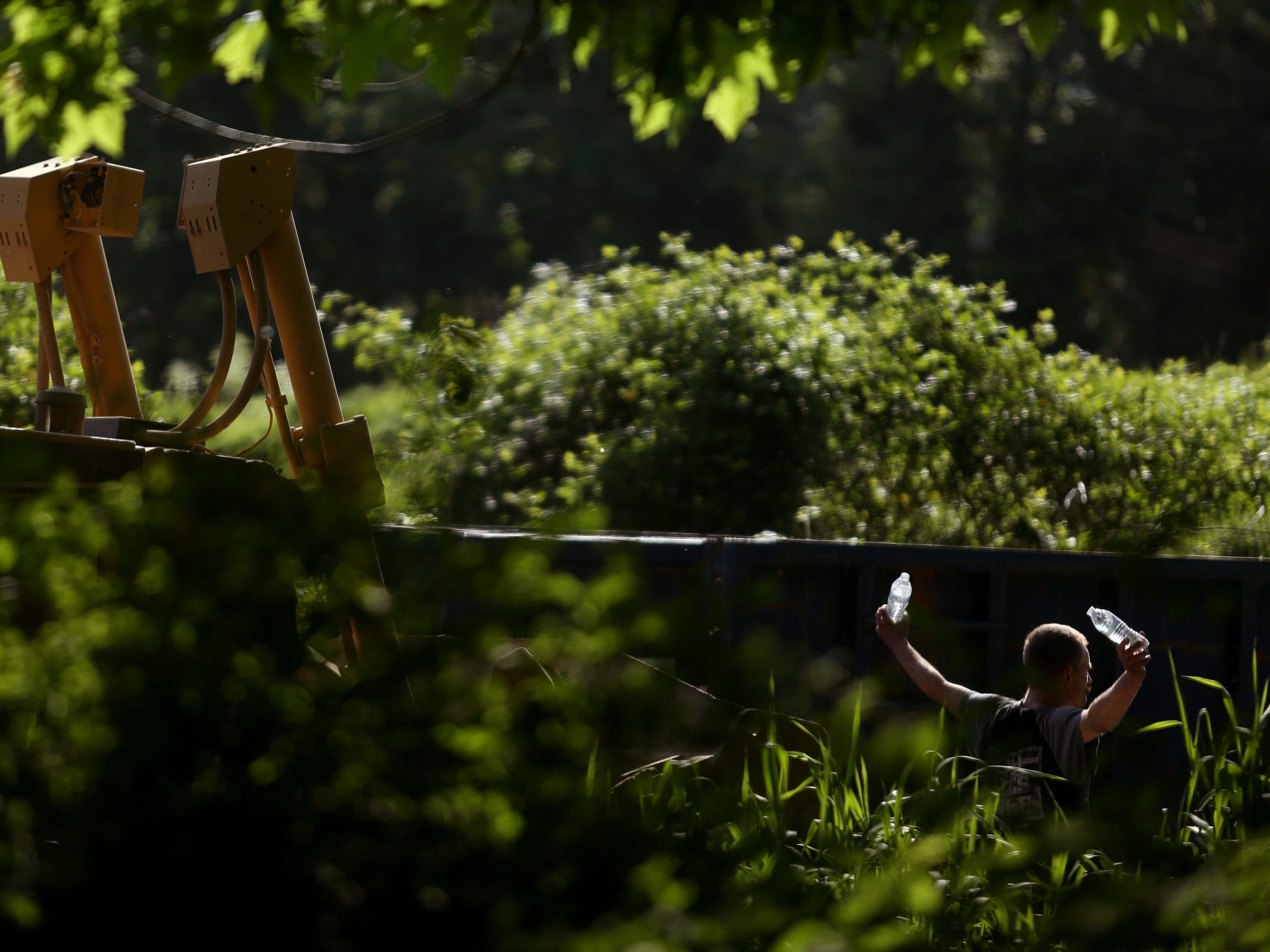 A man living at the homeless camp blocks a bulldozer coming into a privately-owned rock quarry with a homeless camp near Wallace Marine Park in West Salem on May 7, 2019. Signs were posted throughout the camp recently stating personal property must be removed or it will be taken by the landowner and its designated agent starting May 7. An eviction can't be enforced until a court approves it.