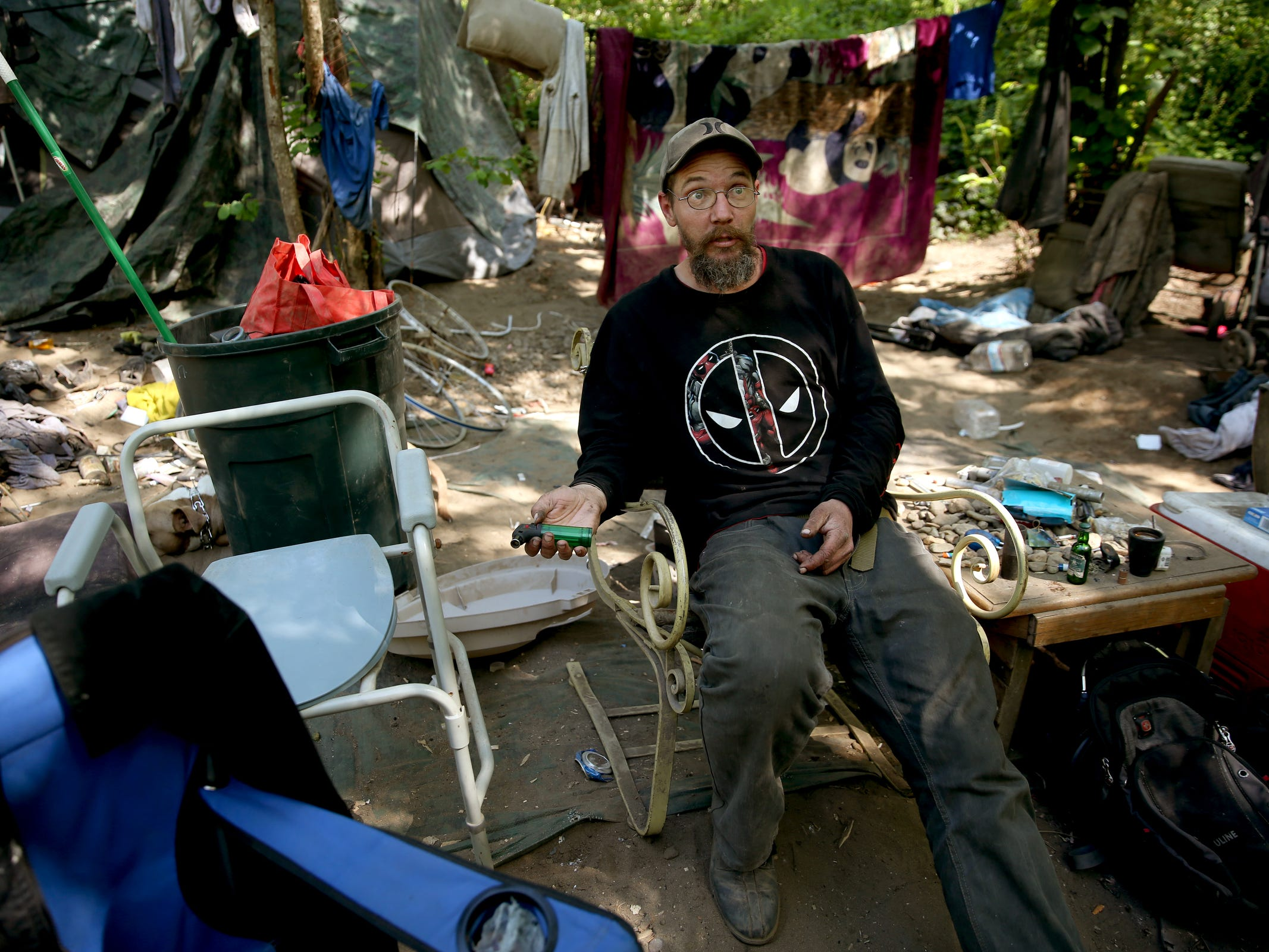 """Anthony Stevens hasn't seen a """"no trespassing"""" sign posted near his area in a homeless camp near Wallace Marine Park, so he plans to stay. Signs were posted throughout the camp recently stating personal property must be removed or it will be taken by the landowner and its designated agent starting May 7. Photographed in West Salem on May 6, 2019."""