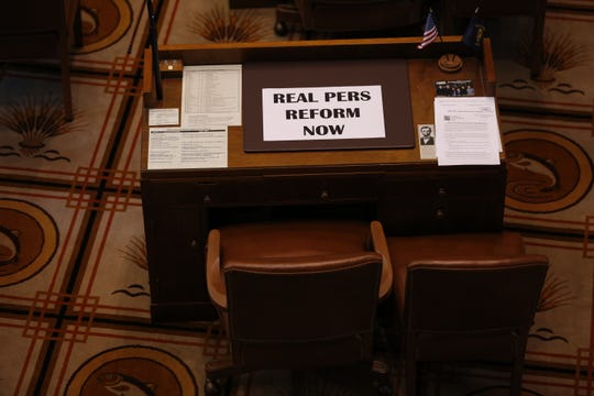 A sign reading ÒReal PERS Reform NowÓ lies on the empty desk of a Republican senators after they didnÕt show up for Senate floor session at the Oregon State Capitol in Salem on May 7, 2019. Republicans denied the Senate a quorum so they could avoid voting on an education revenue bill.