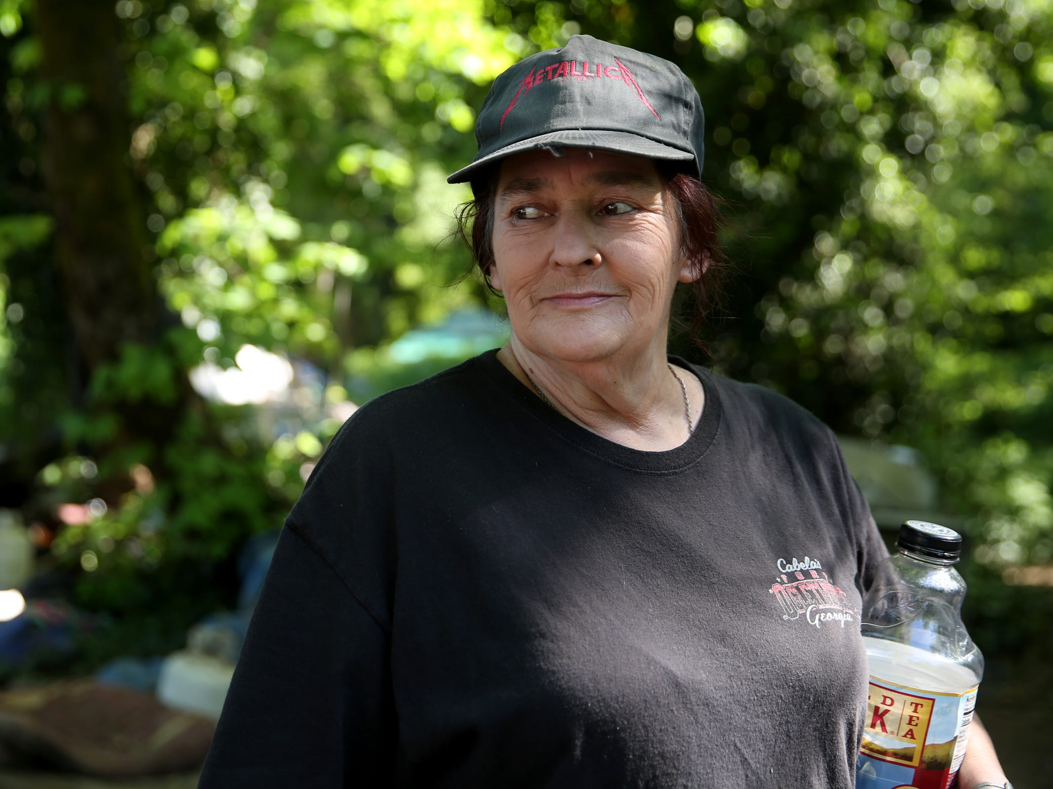 Joan Tomlinson, of West Salem, used to be homeless and now works with others in a homeless camp near Wallace Marine Park in West Salem on May 6, 2019. Signs were posted throughout the camp recently stating personal property must be removed or it will be taken by the landowner and its designated agent starting May 7.