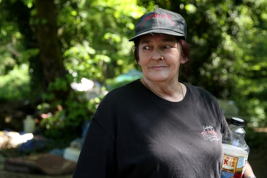 Joan Tomlinson, of West Salem, used to be homeless and now works with others in a homeless camp near Wallace Marine Park in West Salem on May 6, 2019.