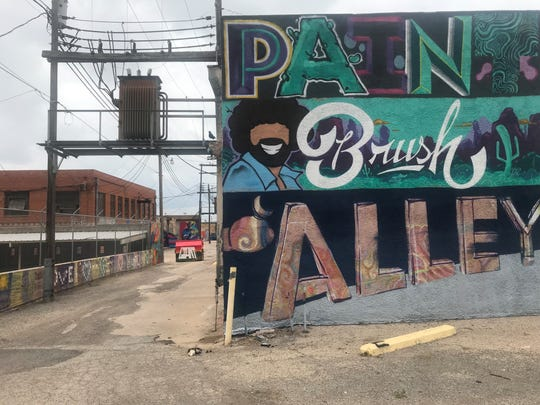 A sign introduces Paintbrush Alley in the 200 block of Irving Street.
