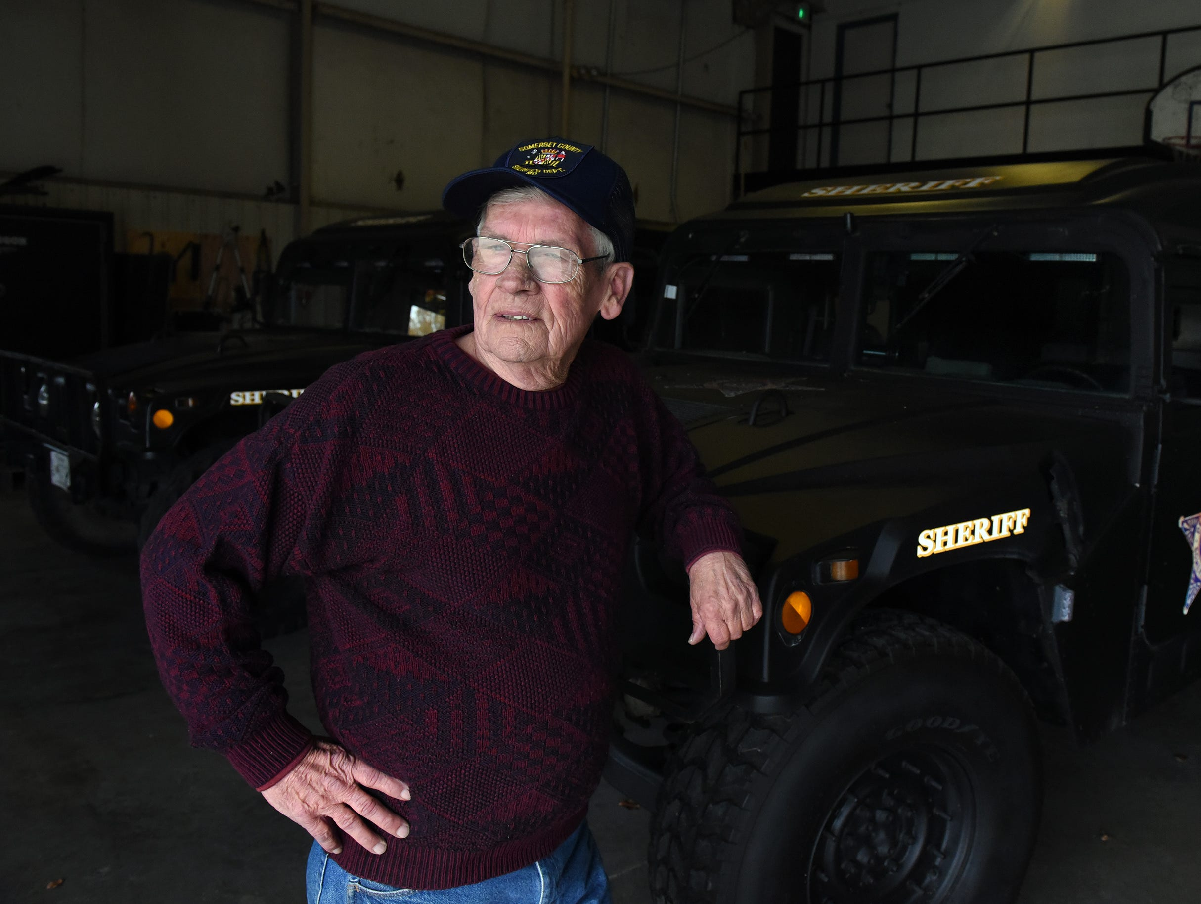 """Somerset County Sheriff Robert """"Bobby"""" Jones stands by one of the department's Humvees a few days before he started his retirement in 2014."""