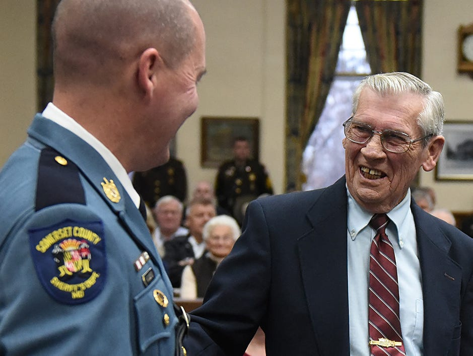 """Retired Somerset County Sheriff Robert """"Bobby"""" Jones congratulates Sheriff Ronnie Howard after he was sworn into office in Princess Anne in 2014."""
