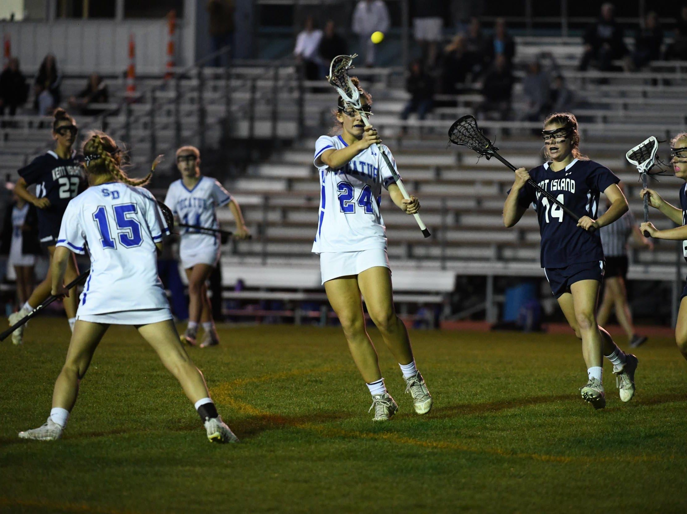 Stephen Decatur's Alyssa Romano with the pass against Kent Island during the Bayside Championship on Monday, May 6, 2019 at Wicomico County Stadium in Salisbury, Md.