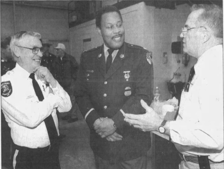 """From left, Somerset County Sheriff Robert """"Bobby"""" Jones, Chief of the Field Operations Bureau of Maryland State Police Lt. Col. William Arrington and Maryland State's Attorney Logan Widdowson talk during the announcement of the establishment of the Somerset Bureau of Investigation in January 2002."""
