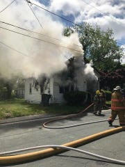 Firefighters battle a house blaze in Onancock in May 2019.