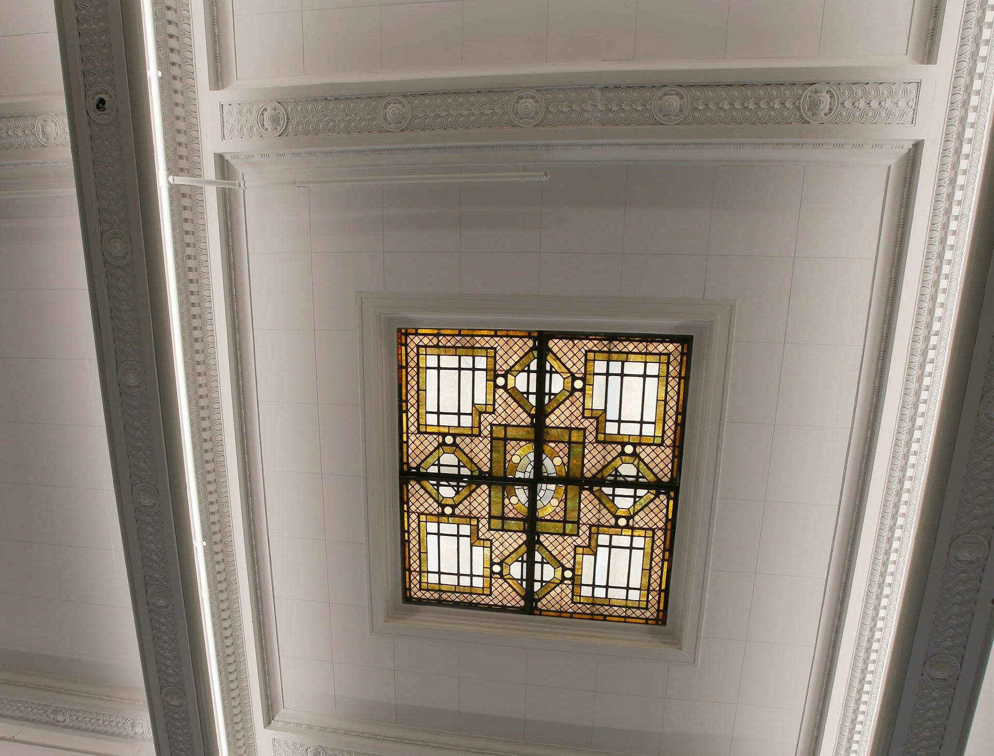 The stained-glass panel was hidden for years in Sheboygan City Council Chambers is now visible as seen, Tuesday, May 7, 2019, in Sheboygan, Wis.  Originally the panel was illuminated by natural light, but today lights illuminate the special feature.