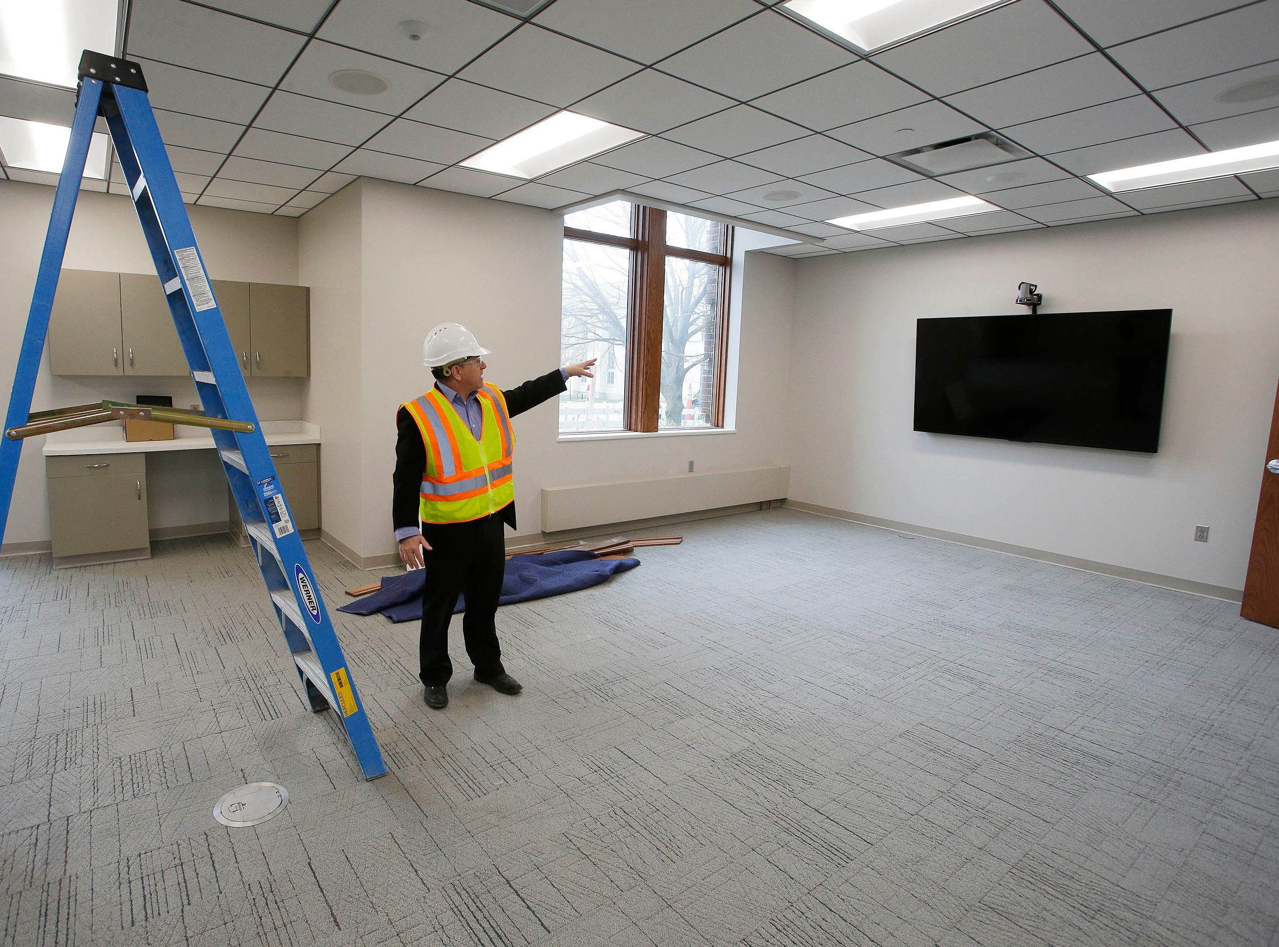 Sheboygan Director of Public Works David Biebel points out one of the multi-media screens seen in a meeting area at Sheboygan City Hall, Tuesday, May 7, 2019, in Sheboygan, Wis.
