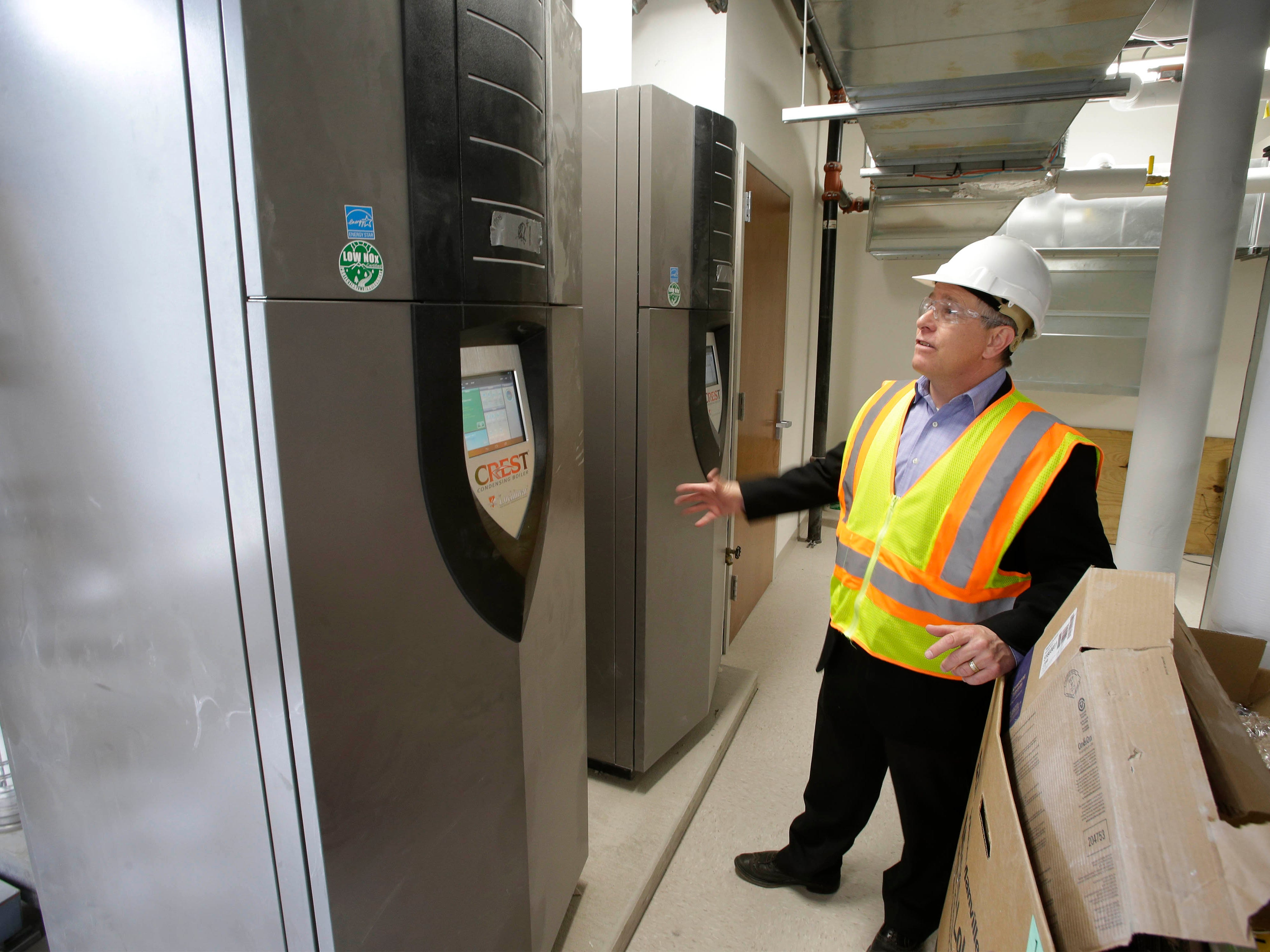 Director of Public Works Dave Biebel points out the new highly efficient boilers that have been installed during the City Hall Remodeling project,Tuesday, May 7, 2019, in Sheboygan, Wis.