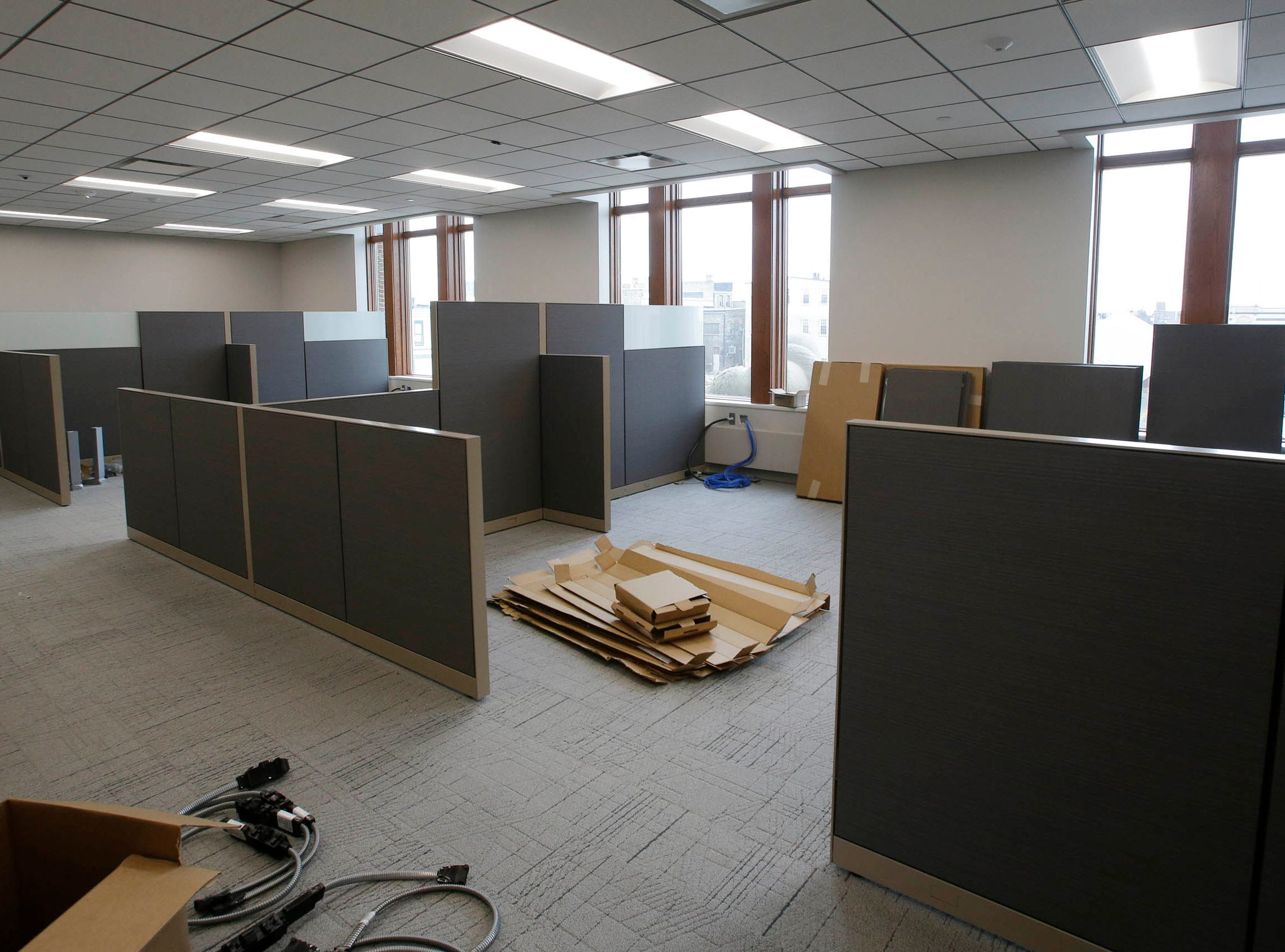 The office partitions are being assembled for the building inspection department, Tuesday, May 7, 2019, in Sheboygan, Wis.