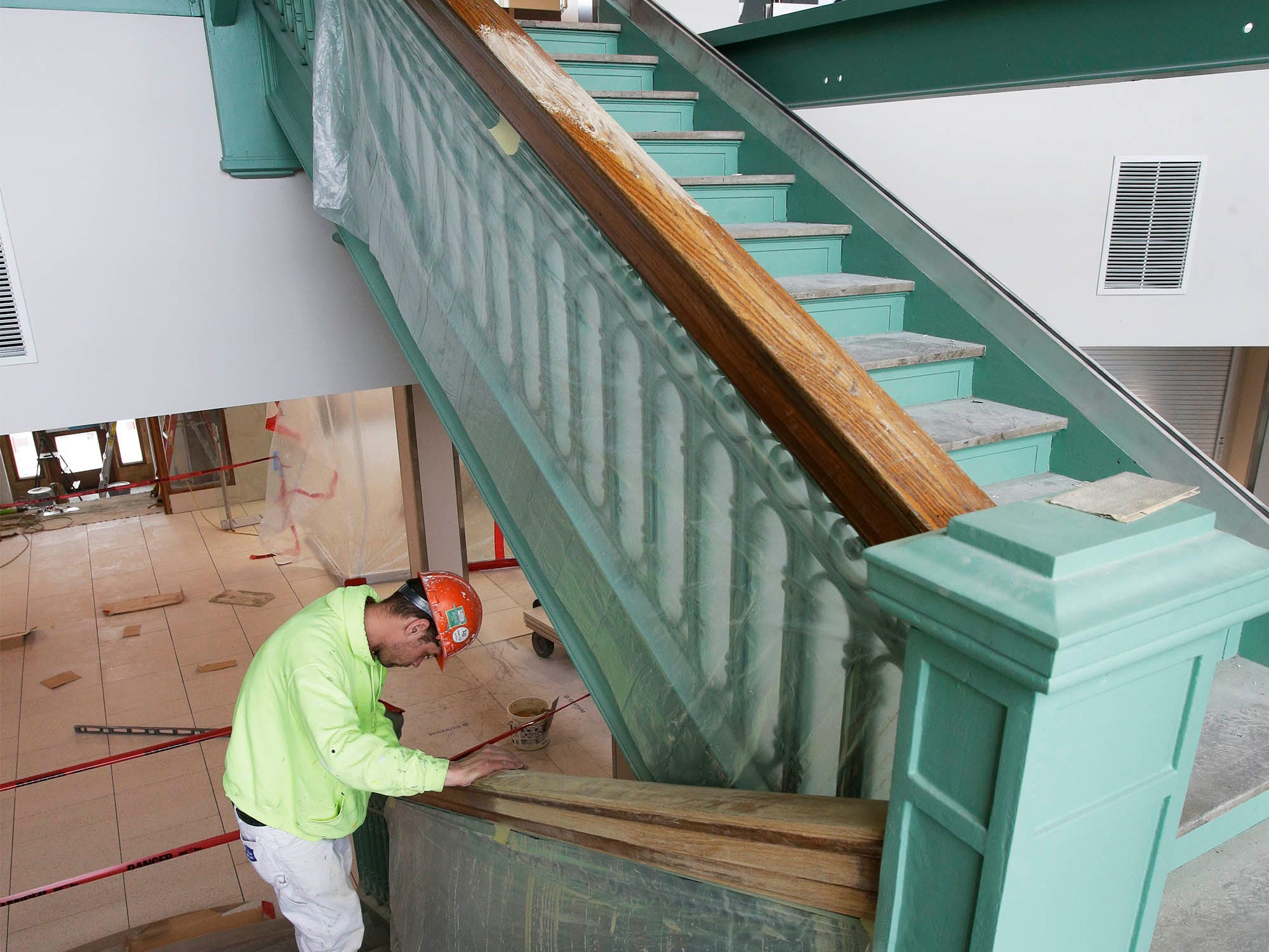 Sheboygan City Hall's ornate main staircase are being refinished, Tuesday, May 7, 2019, in Sheboygan, Wis.