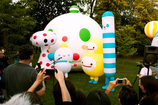 """FriendsWithYou creates """"Rainbow City"""" public art installations and characters. The vinyl inflatables are mutable, air-filled sculptures of various dimensions and colors."""