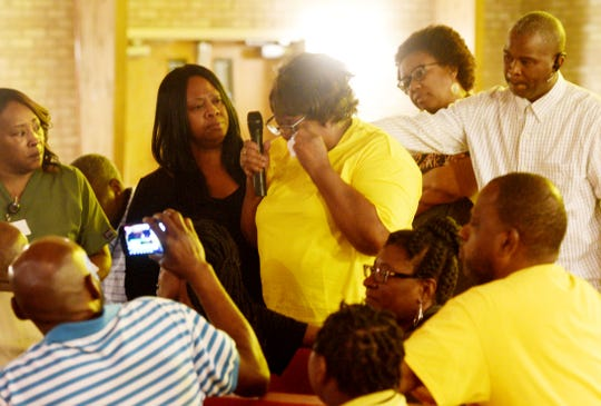 Anthony Childs grandmother, Inez Porter, is surrounded by friends and family when she gets emotional asking questions  during the Community Reconciliation Meeting concerning the death of Anthony Childs Monday evening May 6, 2019 at Winnfield Funeral Home.