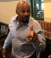 LSU's Kevin Faulk makes a point with the media during Monday's LSU Coaches Caravan stop in Shreveport.