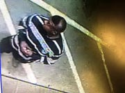 Suspect in Highland arson is seen on a gas station surveillance camera.