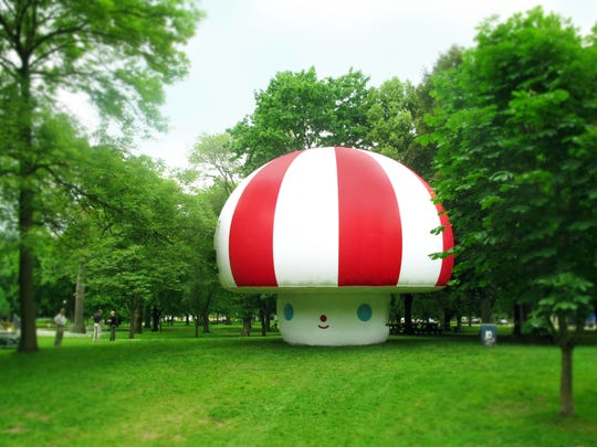 """An """"Rainbow City"""" inflatable character exhibited in Toronto, Canada, created by FriendsWithYou."""
