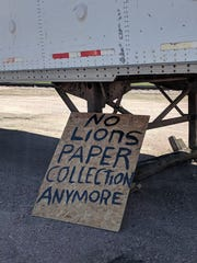 A sign notifying Dell Rapids residents that the Lions Club paper recycling program has come to an end sits next to the final trailer to be hauled out of Dells.