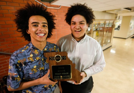 Andre Swai, left, and Emory Williams, of Parkview High School, added to the trophy case of national and state titles behind them by winning the 2019 MSHSAA State Champions in policy debate.