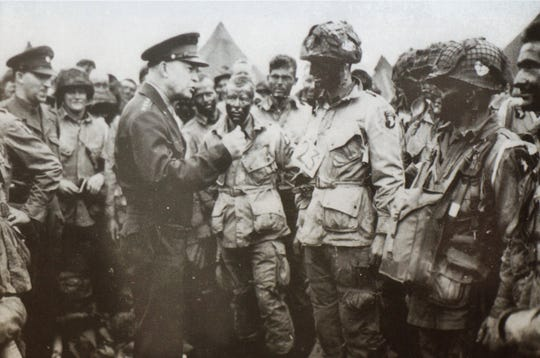 This photo of General Dwioght Eisenhower meeting with paratroopers prior to D-Day. Ralph Manley got to shake Eisenhower's hand on this day.