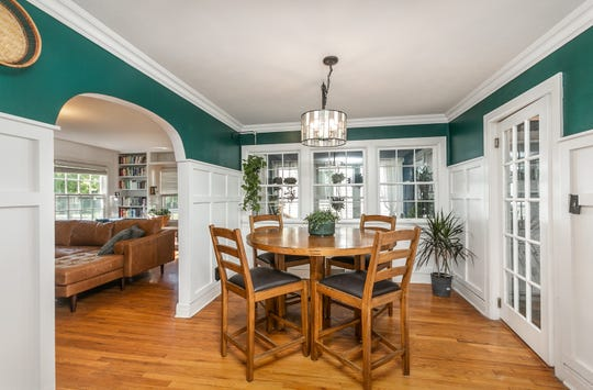 Katie and Christopher added board and batten paneling in the dining room, in keeping with the home's traditional style.