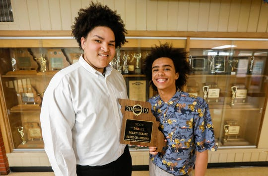 Emory Williams, left, and Andre Swai, of Parkview High School, added to the trophy case of national and state titles behind them by winning the 2019 MSHSAA State Champions in policy debate.
