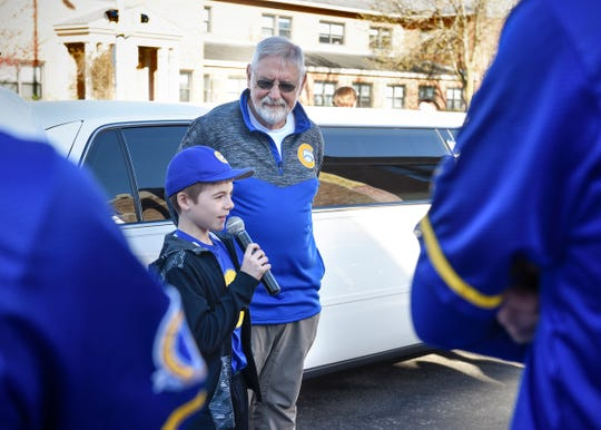 Cole Schwartz, grandson of Bob Karn, thanks students and staff at Cathedral High School for surprising Karn by gathering outside Cathedral before the school day started Tuesday, May 7.
