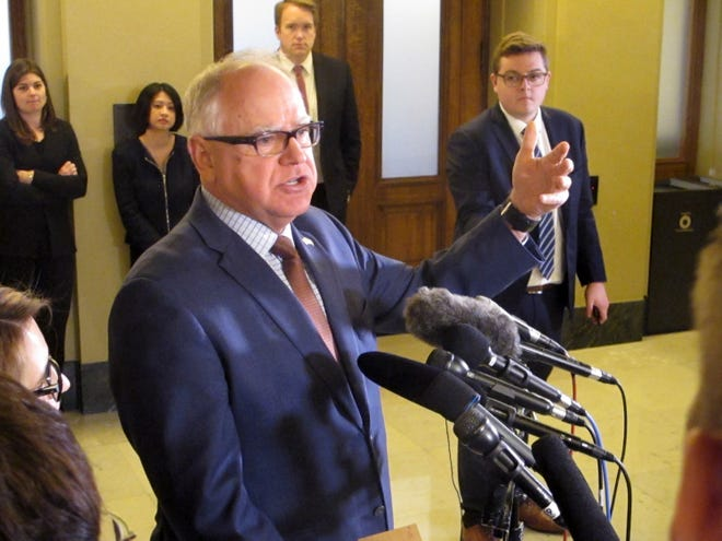 Gov. Tim Walz speaks with reporters at the Capitol in St. Paul on Monday, May 6.