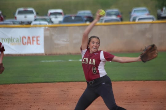 Cedar's Kenzie Waters delivers a pitch with a wind up.