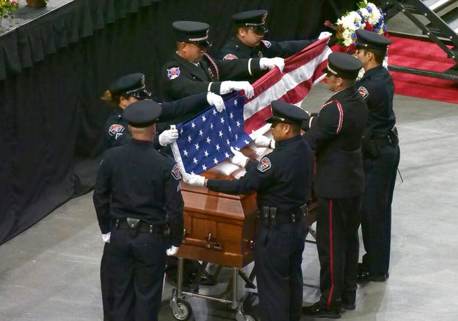 FILE - In this Aug. 17, 2018, file photo, members of an honor guard fold the U.S. flag during flag presentation at the funeral services for Jill Robinson, in West Valley City, Utah. Kevin Wayne Billings, a man accused of fatally shooting Robinson, a West Valley City code-enforcement officer, will likely get life in prison. The Salt Lake Tribune reports that Billings is scheduled to be sentenced Monday, May 6, 2019, morning after pleading guilty in February to aggravated murder, aggravated cruelty to an animal and arson-related charges. (AP Photo/Rick Bowmer, File)