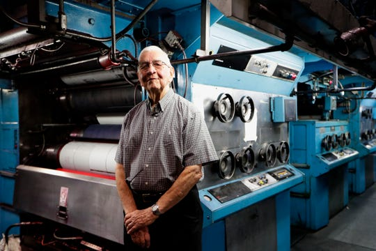 Carrol Dadisman, former publisher for the Tallahassee Democrat, poses for a photo in front of the printing press Friday, May 3, 2019.