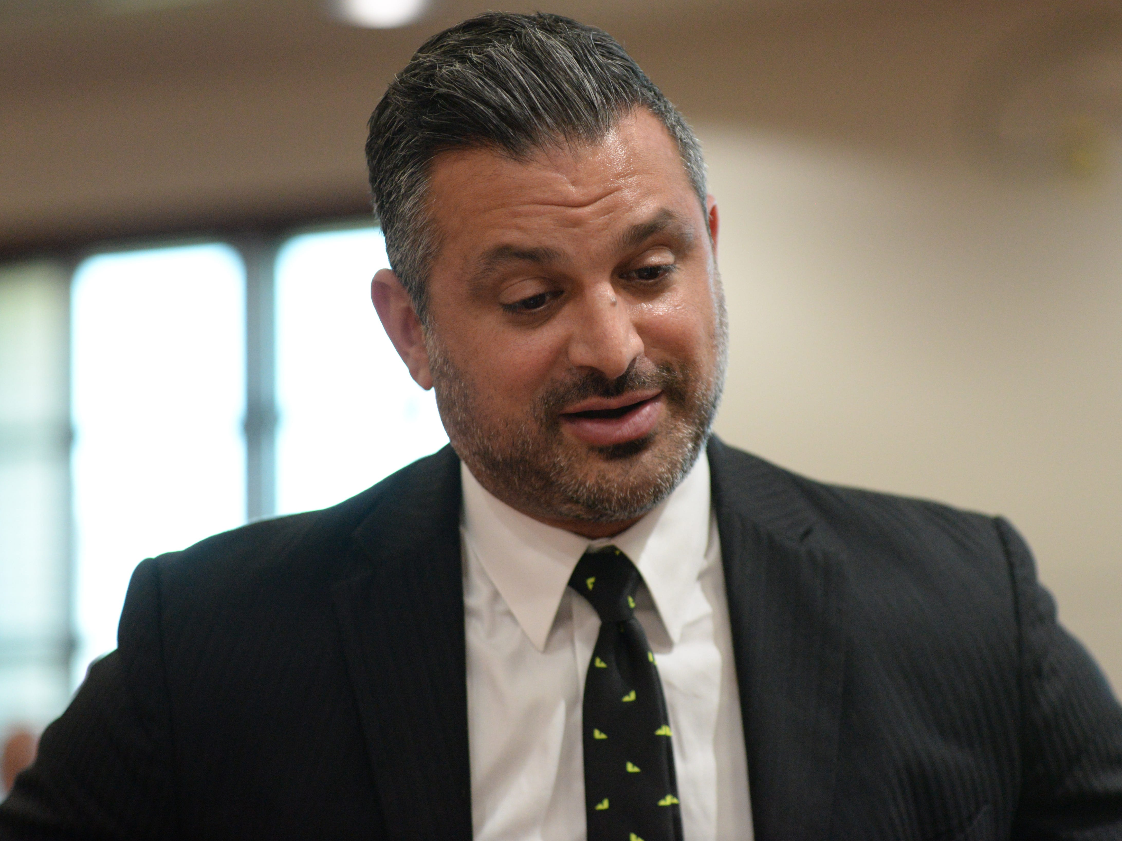 Saam Zengeneh, attorney for Sigfredo Garcia, one of two suspects set to stand trial next month in the murder of Dan Markel, talks to Assistant State Attorney Georgia Cappleman at the Leon County Courthouse Tuesday, May 7, 2019.