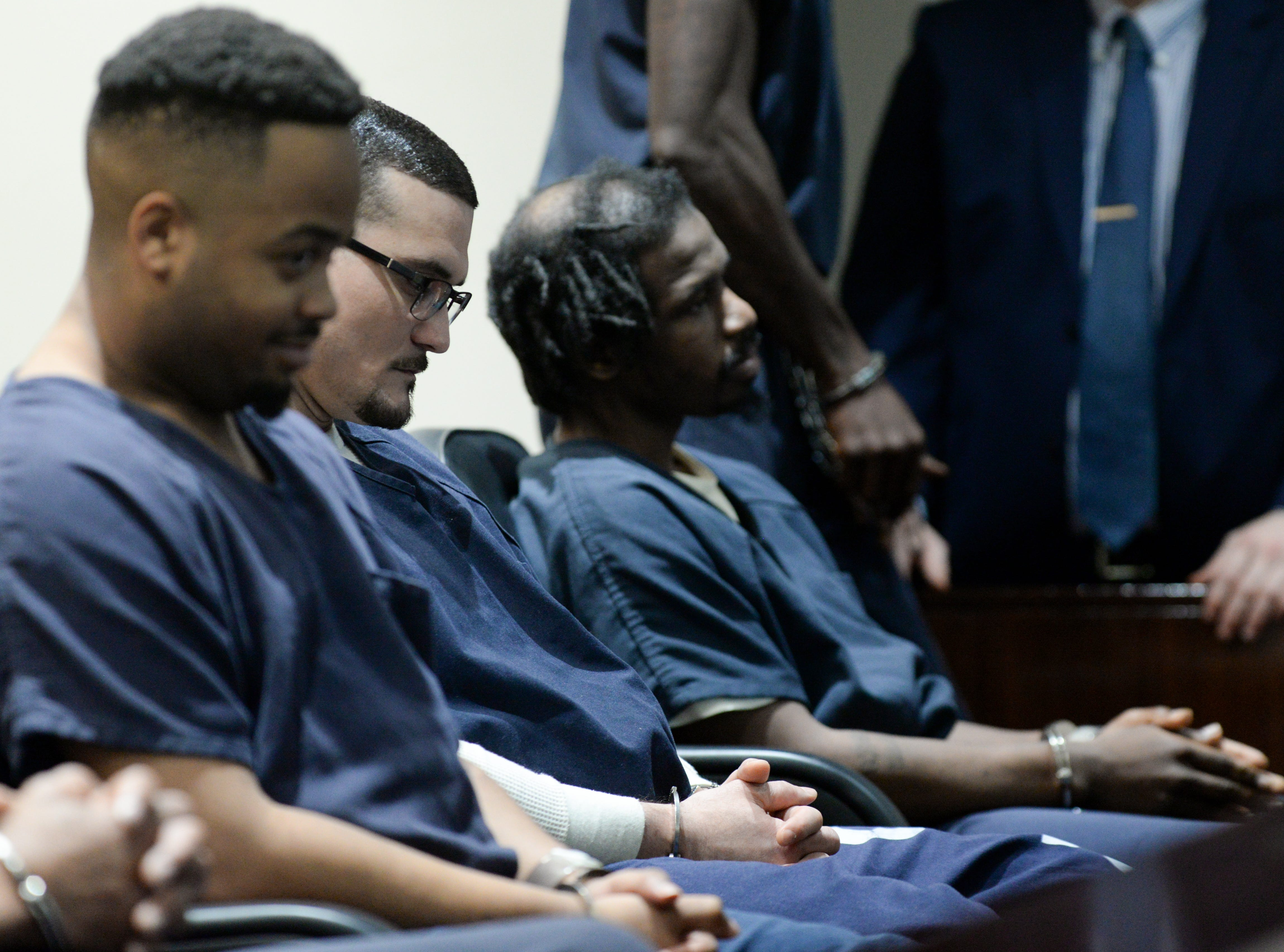 Sigfredo Garcia, center, sits with his handcuffed hands folded in a line of other inmates in a Leon County Courthouse courtroom Tuesday, May 7, 2019. Garcia and his attorney Saam Zengeneh asked Leon County Circuit Judge James C. Hankinson for a continuance and were denied.