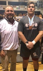 Chiles senior Daniel Ward, next to head coach Kevin Pettis, finished third overall in Class 2A weightlifting in his heavyweight division.