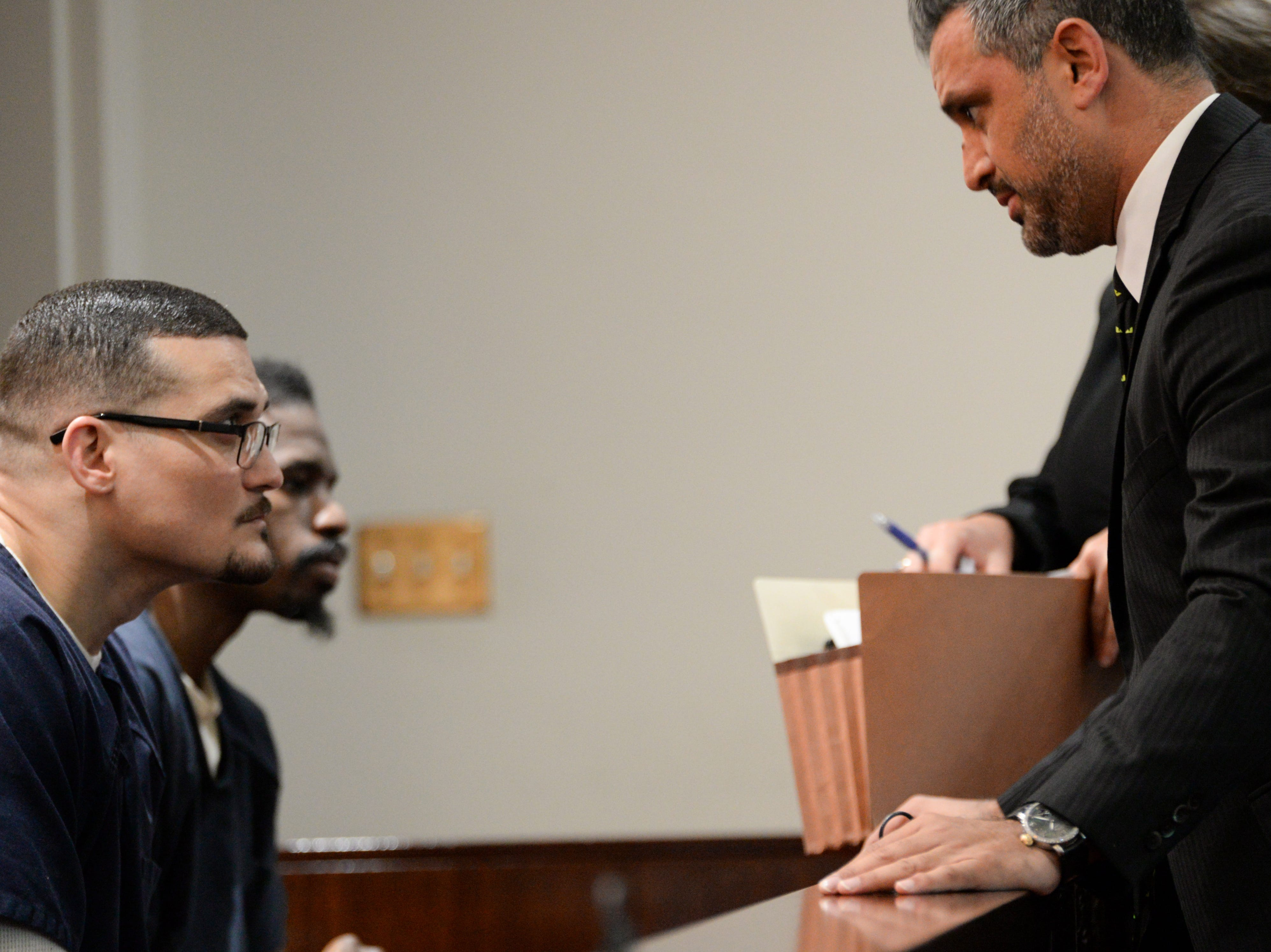 Sigfredo Garcia, one of two suspects set to stand trial next month in the murder of Dan Markel, talks with his attorney Saam Zengeneh at the Leon County Courthouse Tuesday, May 7, 2019. The pair asked Leon County Circuit Judge James C. Hankinson for a continuance and were denied.