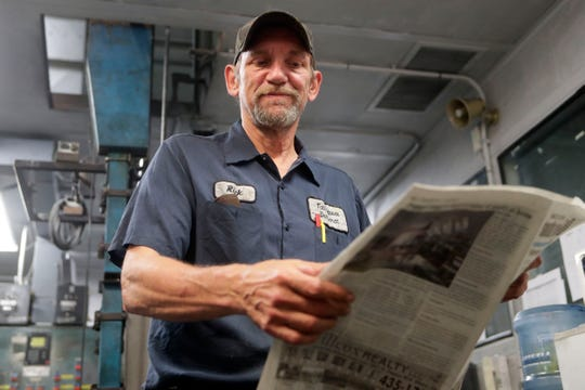 Rick Heidenreich, title-printer for the Tallahassee Democrat, reviews a newspaper hot off the press Friday, May 3, 2019.