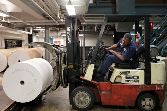 Larry Bradwell, a pressroom paper handler for the Tallahassee Democrat, moves large roles of paper to print newspapers Friday, May 3, 2019.