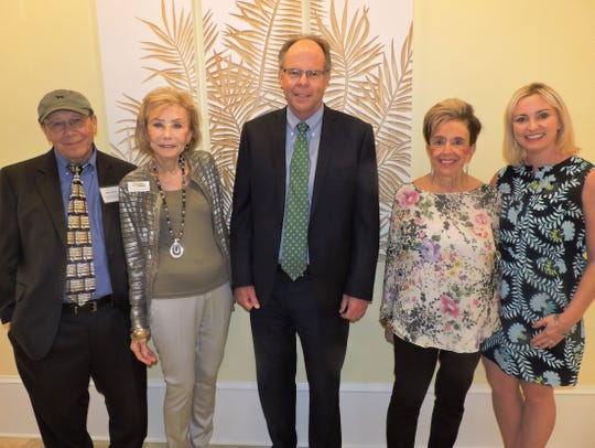 Keynote speaker John Loesser, left, Anne Holmberg, Gerry Saelzer of the Saelzer Atlas Wealth Management Group at Raymond James, Ethel Christin and Katie Norris, also of the Saelzer Atlas Wealth Management Group, at the Sandhill Cove Foundation scholarship presentation.