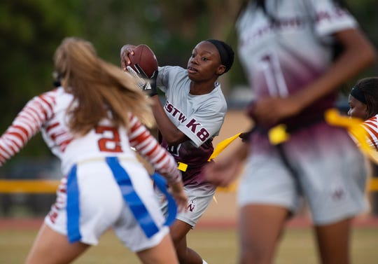 Fort Pierce Westwood's Knaiya Knowles runs the ball upfield in their Region 3-1A championship game against the Harmony High School Longhorns at Lawnwood Stadium on Monday, May 6, 2019, in Fort Pierce.