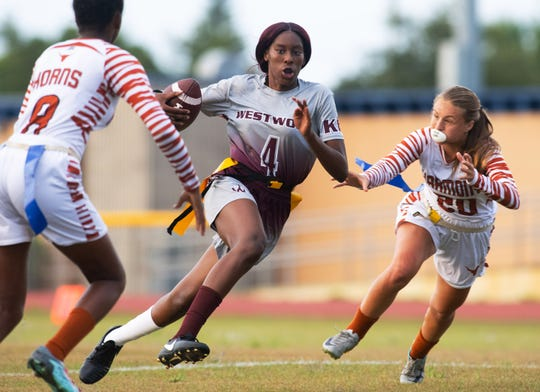 Fort Pierce Westwood's Trenecia Merracks runs the ball upfield in their Region 3-1A championship game against  the Harmony High School Longhorns at Lawnwood Stadium on Monday, May 6, 2019, in Fort Pierce.