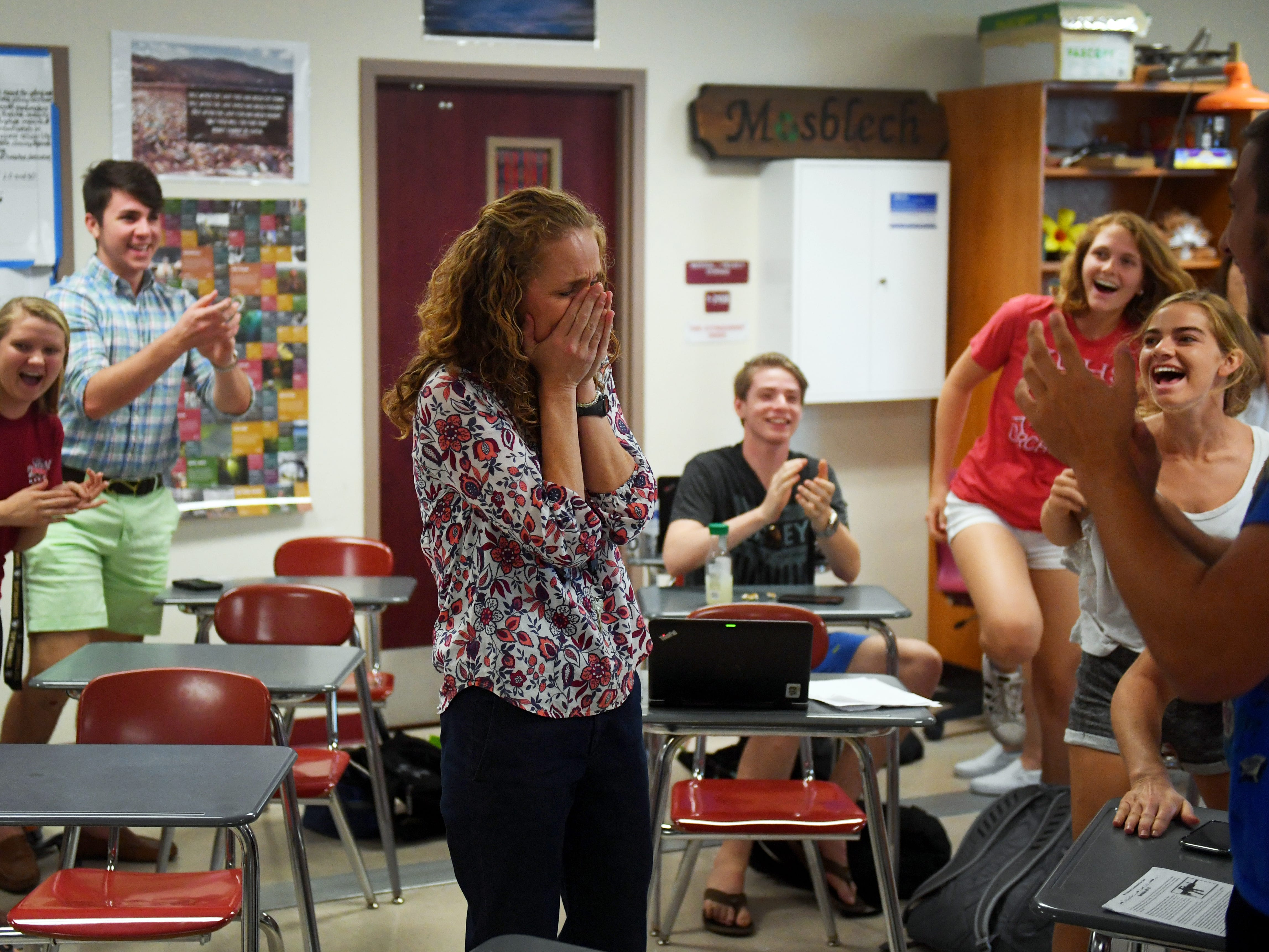 "As her students cheer around her, Dr. Nikki Mosblech, a science teacher at Vero Beach High School, is surprised by staff members from the Florida Department of Education as she is named one of five finalists for the 2020 Florida Teacher of the Year on Tuesday, May 7, 2019. ""It's overwhelming at first,"" Mosblech said. ""It's a lot to be recognized in this way for something that you would come in and do on a regular basis. It's very humbling to think that you could represent educators from around the state."" The announcement of the Teacher of the Year will be made on July 18."