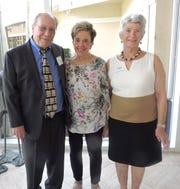 Keynote Speaker John Loesser, left, Ethel Christin and Sandhill Cove Foundation President Ty Forbush at the Sandhill Cove Foundation scholarship presentation.