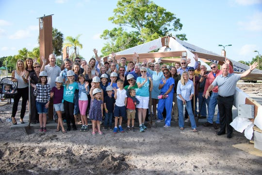 """Supporters and friends gather to commemorate the groundbreaking on March 28 at The Village Club & Preserve property at 2261 S.W. Racquet Club Drive in Palm City. The group stands in front of the future 1,600-square-foot """"Grace Pavilion,"""" made possible through a $75,000 gift from a private foundation. North of the pavilion will stand the 2,250-square-foot community building."""