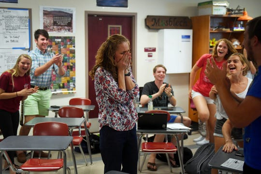 """As her students cheer around her, Dr. Nikki Mosblech, a science teacher at Vero Beach High School, is surprised by staff members from the Florida Department of Education as she is named one of five finalists for the 2020 Florida Teacher of the Year on Tuesday, May 7, 2019 at the school. """"It's overwhelming at first,"""" Mosblech said. """"It's a lot to be recognized in this way for something that you would come in and do on a regular basis. It's very humbling to think that you could represent educators from around the state."""" The announcement of the State Teacher of the Year will be made on July 18."""