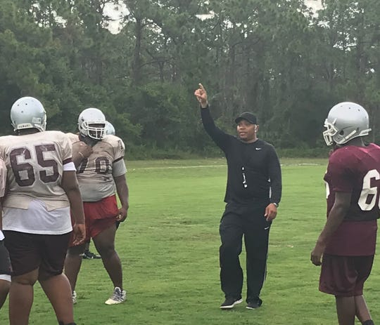 Fort Pierce Westwood coach Jeff George Jr. gives instruction during Tuesday's practice. George Jr. was announced as the Panthers new coach Tuesday.