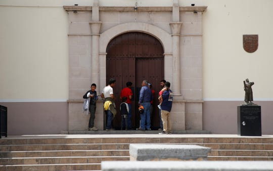 A group of migrants returned to Juárez, under the Trump administration's Migrant Protection Protocols, seek refuge at the Catedral de Nuestra Senora de Guadalupe.