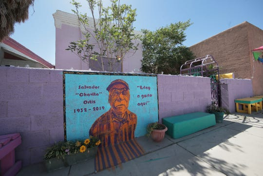 "A mural for longtime Duranguito resident Salvador Ortiz was painted on the wall in front of his house. Ortiz died recently. The mural says, ""I'm happy here,"" in Spanish."